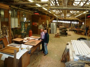 John and Clive pictured in the workshops where his career began over 50 years ago.